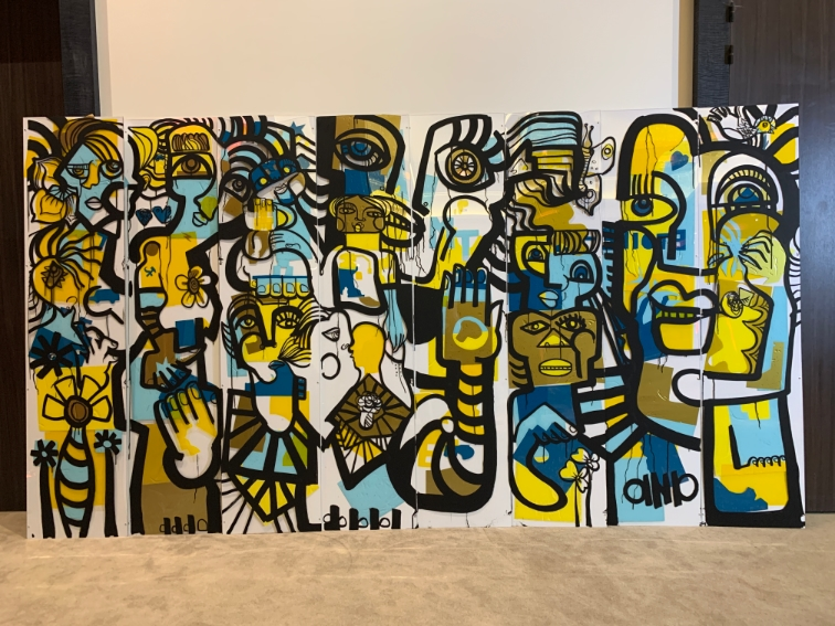 aNa artist is a digital artist but also create live real painting called Paint Tube Plexiglass Mural