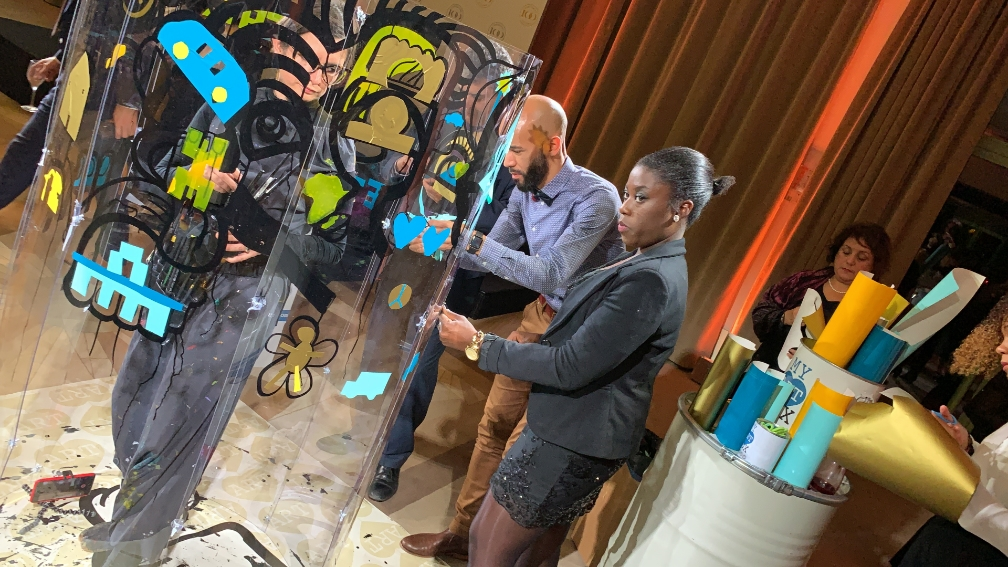 aNa artist works out Collaborative Action Art Painting inside a huge plexiglass tube : The paint Tube